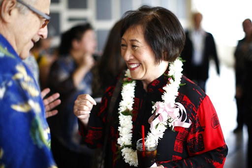 (AP Photo/Marco Garcia, File). In this April 28, 2018 photo, U.S. Rep. Colleen Hanabusa, D-Hawaii, who is giving up her seat in Congress to run for Hawaii governor, talks with a guest at an event in Honolulu. Hawaii Gov. David Ige faces a stiff challen...