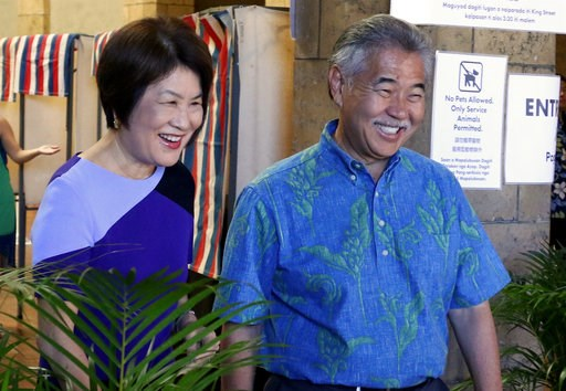 (AP Photo/Caleb Jones). In this Wednesday, Aug. 8, 2018 photo, Hawaii Gov. David Ige, right, and first lady Dawn Amano Ige smile after voting early in the state's primary election in Honolulu. Ige is seeking the nomination for a second term in office i...