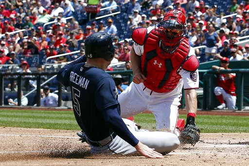 (AP Photo/Alex Brandon). Washington Nationals catcher Matt Wieters makes the tag at home plate on Atlanta Braves' Freddie Freeman during the third inning of a baseball game at Nationals Park, Thursday, Aug. 9, 2018, in Washington.