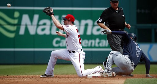(AP Photo/Alex Brandon). Atlanta Braves' Freddie Freeman slides into second base for a double as Washington Nationals second baseman Daniel Murphy waits for the throw during the third inning of a baseball game at Nationals Park, Thursday, Aug. 9, 2018,...