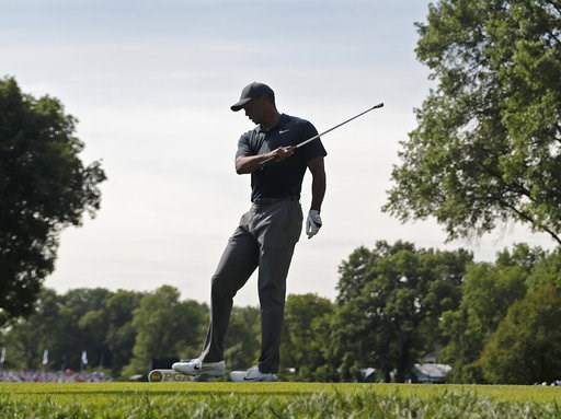 (AP Photo/Jeff Roberson). Tiger Woods reacts to his tee shot on the 16th hole during the first round of the PGA Championship golf tournament at Bellerive Country Club, Thursday, Aug. 9, 2018, in St. Louis.
