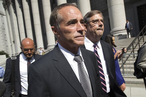 (AP Photo/Mary Altaffer). Republican U.S. Rep. Christopher Collins, center, leaves federal court, Wednesday, Aug. 8, 2018, in New York. Rep. Collins of western New York state has been indicted on charges that he used inside information about a biotechn...