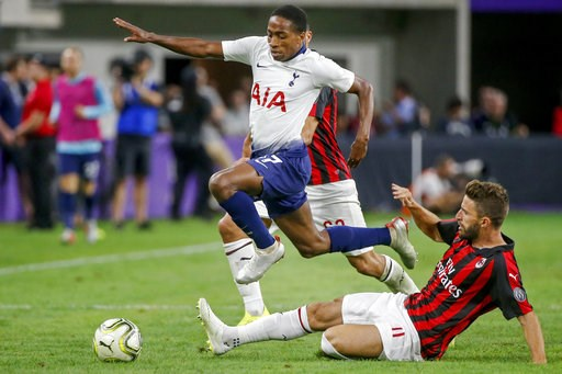 (AP Photo/Bruce Kluckhohn). Tottenham Hotspur defender Kyle Walker-Peters (37) leaps over the slide tackle of AC Milan forward Fabio Borini (11) during an International Champions Cup soccer match, Tuesday, July 31, 2018 in Minneapolis. Tottenham Hotspu...