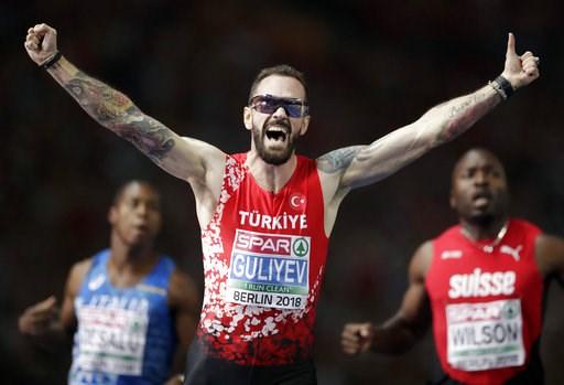 (AP Photo/Michael Sohn). Turkey's Ramil Guliyev celebrates winning the men's 200 meter final race at the European Athletics Championships in Berlin, Germany, Thursday, Aug. 9, 2018.