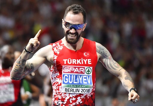 (AP Photo/Martin Meissner). Turkey's Ramil Guliyev celebrates after winning the gold medal after the men's 200-meter final at the European Athletics Championships at the Olympic stadium in Berlin, Germany, Thursday, Aug. 9, 2018.