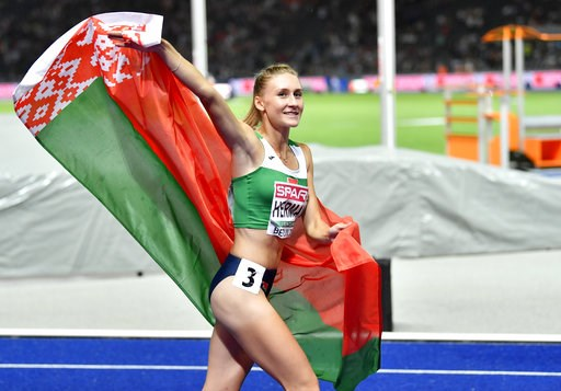(AP Photo/Martin Meissner). Belarus' Elvira Herman celebrates after winning the gold medal in the women's 100-meter hurdles final at the European Athletics Championships at the Olympic stadium in Berlin, Germany, Thursday, Aug. 9, 2018.