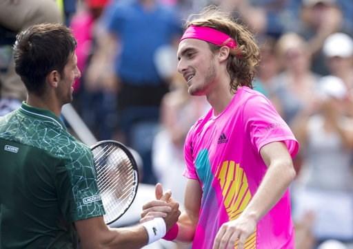 (Frank Gunn/The Canadian Press via AP). Novak Djokovic, left, of Serbia, congratulates Stefanos Tsitsipas, of Greece, after their match at the Rogers Cup men's tennis tournament in Toronto, Thursday, Aug. 9, 2018.