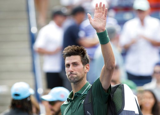 (Frank Gunn/The Canadian Press via AP). Novak Djokovic, of Serbia, waves to the crowd after loss to Stefanos Tsitsipas, of Greece, during the Rogers Cup men's tennis tournament in Toronto, Thursday, Aug. 9, 2018.