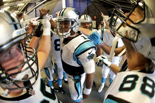 (AP Photo/Julio Cortez). Carolina Panthers quarterback Cam Newton, center, gives a pep talk to his team before taking the field prior to an NFL football game against the Buffalo Bills, Thursday, Aug. 9, 2018, in Orchard Park, N.Y.