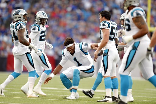 (AP Photo/Adrian Kraus). Carolina Panthers quarterback Cam Newton, center, jokes with teammates after linebacker Shaq Green-Thompson, far left, intercepted a pass from Buffalo Bills quarterback Nathan Peterman (not pictured) during the first half of an...