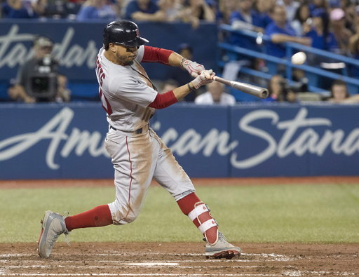 (Fred Thornhill/The Canadian Press via AP). Boston Red Sox's Mookie Betts hits a home run against the Toronto Blue Jays during the ninth inning of a baseball game Thursday, Aug. 9, 2018, in Toronto.