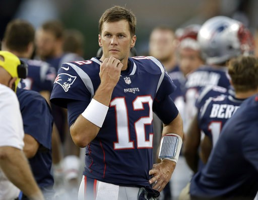 (AP Photo/Charles Krupa). New England Patriots quarterback Tom Brady watches from the sideline during the first half of a preseason NFL football game against the Washington Redskins, Thursday, Aug. 9, 2018, in Foxborough, Mass.