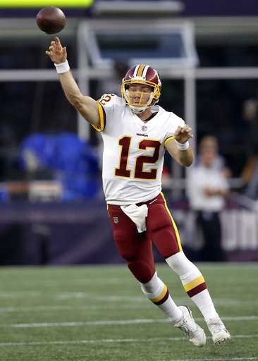 (AP Photo/Charles Krupa). Washington Redskins quarterback Colt McCoy passes against the New England Patriots during the first half of a preseason NFL football game, Thursday, Aug. 9, 2018, in Foxborough, Mass.