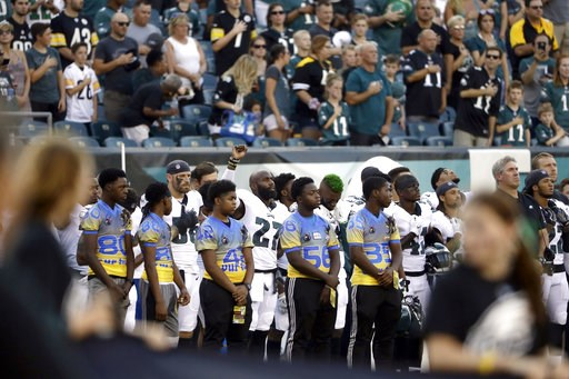 (AP Photo/Matt Rourke). Philadelphia Eagles' Malcolm Jenkins, center left, raises his fist during the national anthem before the team's preseason NFL football game against the Pittsburgh Steelers, Thursday, Aug. 9, 2018, in Philadelphia.