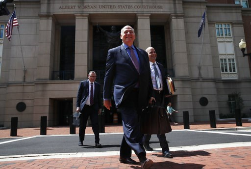 (AP Photo/Jacquelyn Martin). The defense team for Paul Manafort, including Thomas Zehnle, center, and Jay Nanavati, right, leave federal court for a lunch break during the trial of the former Trump campaign chairman, in Alexandria, Va., Thursday, Aug. ...