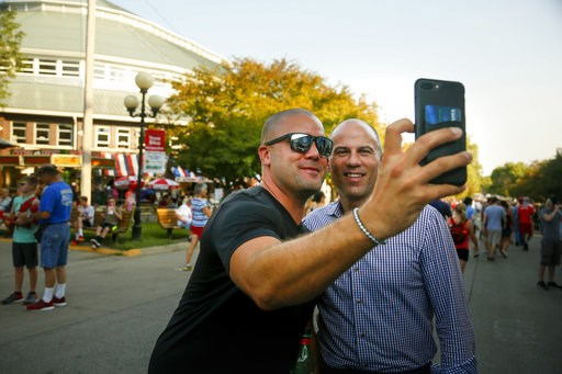 (Zach Boyden-Holme/The Des Moines Register via AP). Michael Avenatti, the lawyer representing adult film actress Stormy Daniels, poses for a selfie with a fairgoer at the Iowa State Fair in Des Moines, Iowa, Thursday, Aug. 9, 2018. Avenatti's crusade f...