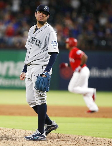 (AP Photo/Brandon Wade). Seattle Mariners starting pitcher Felix Hernandez waits as Texas Rangers' Adrian Beltre rounds the bases after hitting a solo home run during the sixth inning of a baseball game Tuesday, Aug. 7, 2018, in Arlington, Texas. The R...
