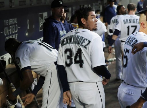 (AP Photo/Ted S. Warren). Seattle Mariners starting pitcher Felix Hernandez (34) walks in the dugout after the fourth inning of a baseball game against the Toronto Blue Jays, Thursday, Aug. 2, 2018, in Seattle. The Blue Jays won 7-3.
