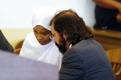 (AP Photo/Morgan Lee). Hujrah Wahhaj appears in New Mexico state district court to plead not guilty to charges of child abuse in Taos, N.M., Wednesday, Aug. 8, 2018, alongside public defense attorney Aleks Kostich. Hujrah Wahhaj was arrested Friday in ...