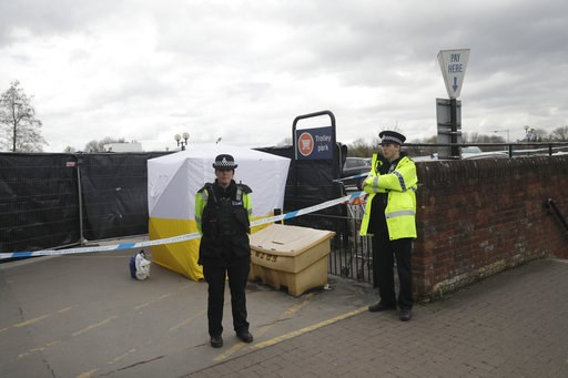 (AP Photo/Matt Dunham, File). FILE - In this March 13, 2018, file photo, police officers guard a cordon around a police tent covering a supermarket car park pay machine near the spot where former Russian spy Sergei Skripal and his daughter were found c...