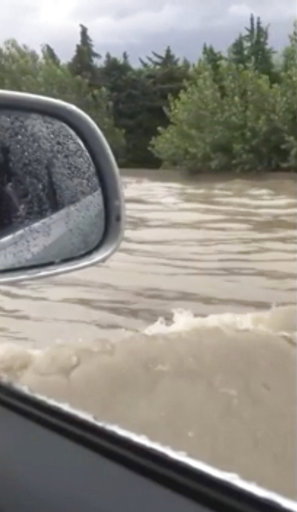 (Stéphane Decoux via AP). In this image from video, flash floods send a torrent of water down a street in Aubagne, France on Thursday, Aug. 9, 2018. Hundreds of rescuers backed by helicopters evacuated about 1,600 people, most of them campers, in three...