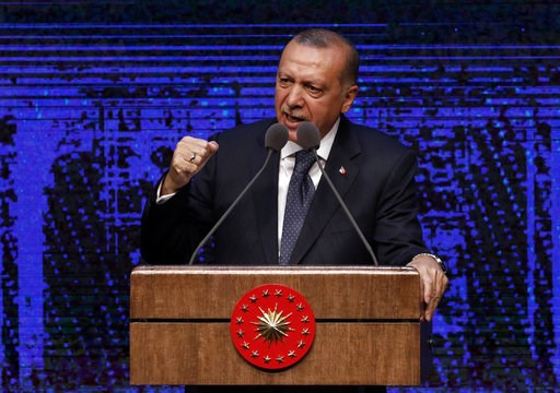 (AP Photo/Burhan Ozbilici). Turkey's President Recep Tayyip Erdogan announces plan of action for the first 100 days of his new presidency, in Ankara, Turkey, Friday, Aug. 3, 2018.