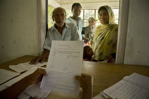 (AP Photo/Anupam Nath). People whose names were left out in the National Register of Citizens (NRC) draft stand to collect forms to file appeals in Mayong, 45 kilometers (28 miles) east of Gauhati, India, Friday, Aug. 10, 2018. A draft list of citizens...