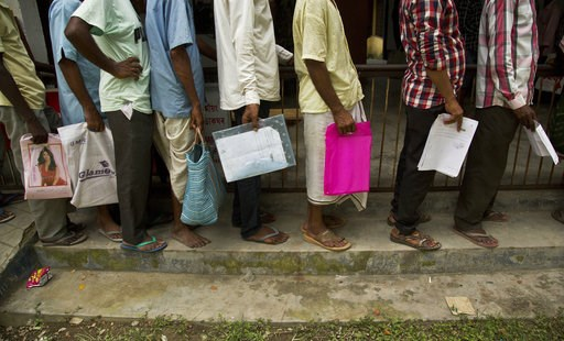 (AP Photo/Anupam Nath). People whose names were left out in the National Register of Citizens (NRC) draft stand in a queue to collect forms to file appeals in Mayong, 45 kilometers (28 miles) east of Gauhati, India, Friday, Aug. 10, 2018. A draft list ...