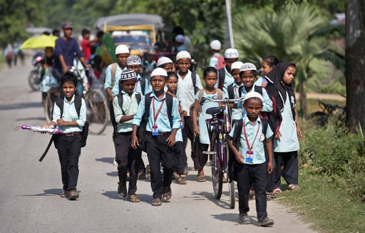(AP Photo/Anupam Nath). In this Thursday, Aug. 9, 2018 photo, school children walk on a road in Mayong, 45 kilometers (28 miles) east Gauhati, India. A draft list of citizens in Assam, released in July, put nearly 4 million people on edge to prove thei...
