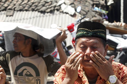 (AP Photo/Firdia Lisnawati). A man weeps as he prays during Muslim Friday prayers in North Lombok, Indonesia, Friday, Aug. 10, 2018. The north of Lombok was devastated by a powerful earthquake that struck Sunday night, damaging thousands of buildings a...