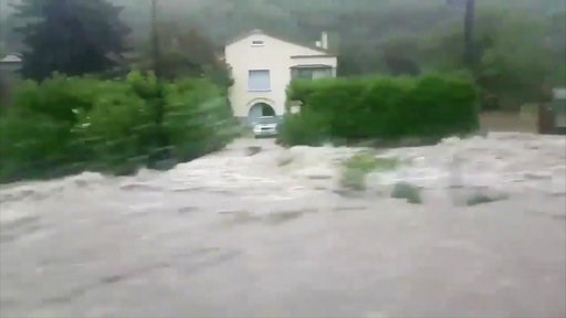 (Loic Spadafora via AP). A home appears cut off as a torrent of water rushes past, in Saint Ambroix, France, Thursday Aug. 9, 2018. Heavy rain has caused flash flooding, transforming rivers and streams into torrents, the interior minister Gerard Collom...