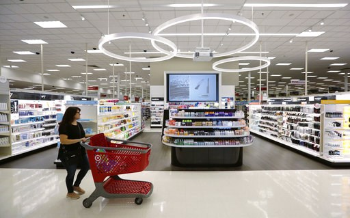 (AP Photo/Eric Gay, File). FILE- In this May 30, 2018, file photo, a shopper walks through the updated cosmetic department at a Target store in San Antonio. On Friday, Aug. 10, the Labor Department reports on U.S. consumer prices for July.