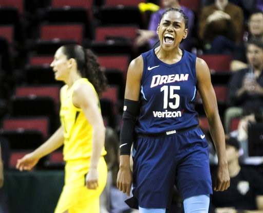 (Bettina Hansen/The Seattle Times via AP, File). FILE - In this June 10, 2018, file photo, Atlanta Dream guard Tiffany Hayes (15) celebrates making a shot and drawing the foul during the second half of a WNBA basketball game against the Seattle Storm i...