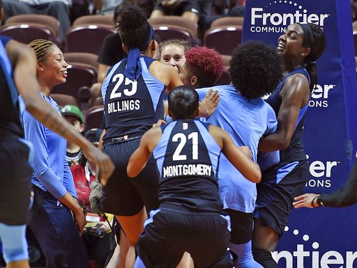 (Sean D. Elliot/The Day via AP, File). FILE - In this July 17, 2018, file photo, Atlanta Dream players mob Tiffany Hayes after her buzzer-beating 3-pointer against the Connecticut Sun at the end of a WNBA basketball game in Uncasville, Conn. With that ...
