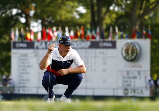(AP Photo/Jeff Roberson). Gary Woodland looks at a putt on the 18th green during the first round of the PGA Championship golf tournament at Bellerive Country Club, Thursday, Aug. 9, 2018, in St. Louis.