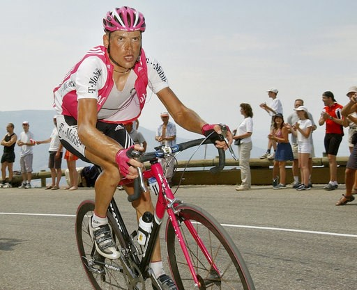(AP Photo/Peter Delong, file). FILE - In this July 20, 2004 file photo T-Mobile team leader Jan Ullrich of Germany pedals during his attack in the ascent of the Echarasson pass during the 15th stage of the Tour de France cycling race between Valreas, s...