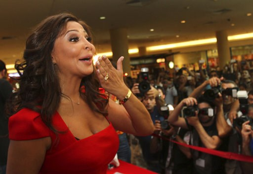 (AP Photo). In this July 13, 2012, photo, Lebanese diva Elissa, whose real name is Elissar Khoury, one of the best known and highest-selling female artists in the Arab world, kisses her fans, in Beirut, Lebanon. Elissa broke taboos this week with a vid...