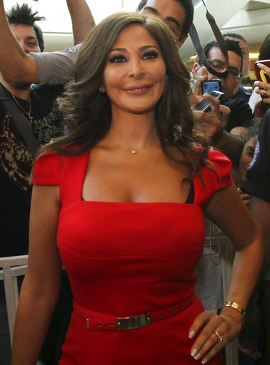 (AP Photo). In this July 13, 2012, photo, Lebanese diva Elissa, whose real name is Elissar Khoury, one of the best known and highest-selling female artists in the Arab world, poses for photographers, in Beirut, Lebanon. Elissa broke taboos this week wi...