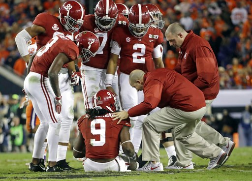 (AP Photo/David J. Phillip, File). FILE - In this Jan. 9, 2017, file photo, Alabama's Bo Scarbrough is looked at after being hurt during the second half of the NCAA college football playoff championship game against Clemson in Tampa, Fla. Player privac...