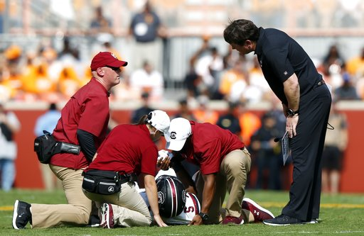 (AP Photo/Wade Payne, File). FILE - In this Oct. 14, 2017, file photo, South Carolina head coach Will Muschamp, right, checks on running back Rico Dowdle (5) after he was injured in the first half of an NCAA college football game against Tennessee in K...