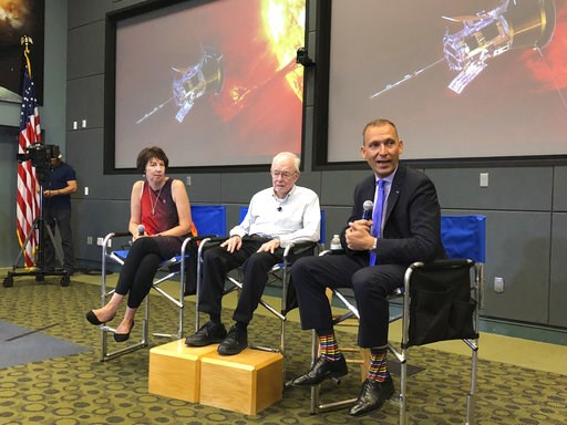 (AP Photo/Marcia Dunn). In this Thursday, Aug. 9, 2018 photo, astrophysicist Eugene Parker sits between Johns Hopkins University project scientist Nicola Fox, left, and NASA's science mission chief Thomas Zurbuchen, during a news conference about the P...