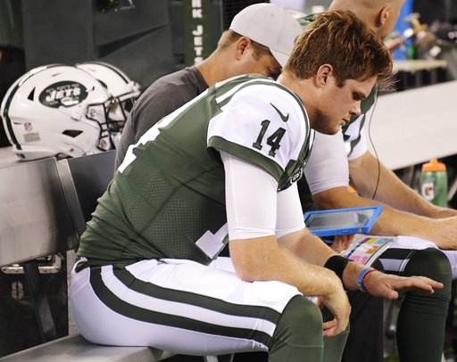 (AP Photo/Bill Kostroun). New York Jets quarterback Sam Darnold (14) looks at his hand after hurting it during the first half of a preseason NFL football game against the Atlanta Falcons, Friday, Aug. 10, 2018, in East Rutherford, N.J.