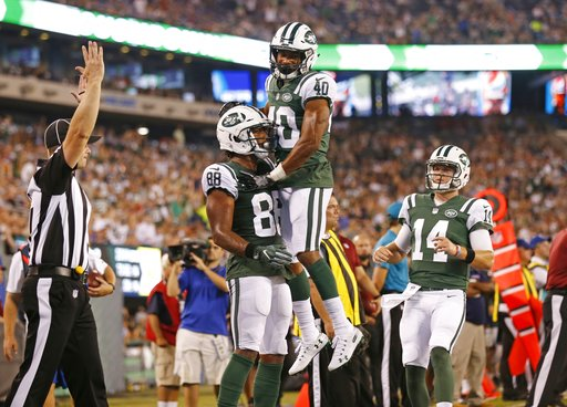 (AP Photo/Adam Hunger). New York Jets quarterback Sam Darnold (14) runs toward Trenton Cannon (40) as he celebrates with Charles D. Johnson (88) after Johnson caught a pass for a touchdown during the first half of a preseason NFL football game against ...