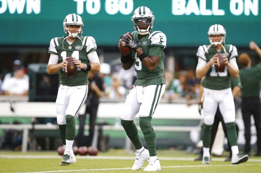 (AP Photo/Adam Hunger). New York Jets quarterback Teddy Bridgewater (5) warms up with teammates Sam Darnold (14) and Josh McCown (15) before a preseason NFL football game against the Atlanta Falcons, Friday, Aug. 10, 2018, in East Rutherford, N.J.