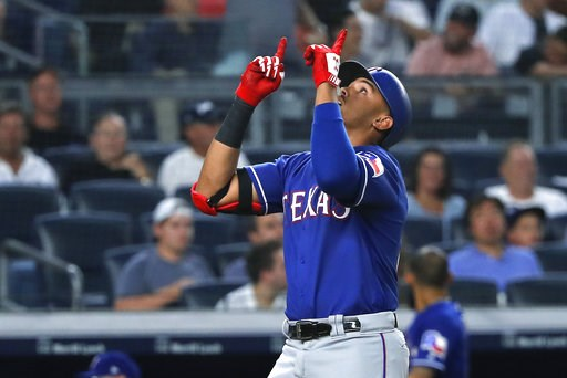 (AP Photo/Julie Jacobson). Texas Rangers' Ronald Guzman reacts as he crosses the plate after hitting a solo home run against the New York Yankees during the fourth inning of a baseball game Friday, Aug. 10, 2018, in New York.