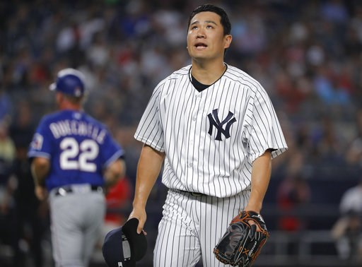 (AP Photo/Julie Jacobson). New York Yankees starting pitcher Masahiro Tanaka walks off the field at the end of the top of the fourth inning of a baseball game against the Texas Rangers, Friday, Aug. 10, 2018, in New York.