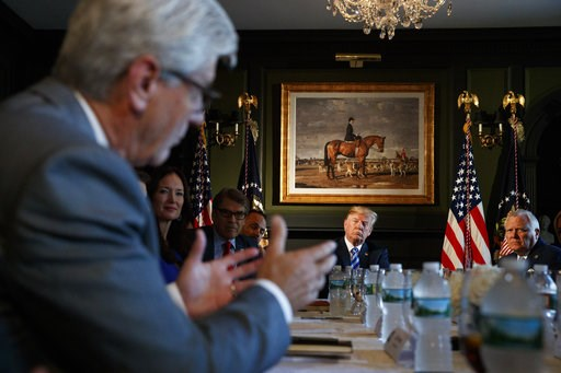 (AP Photo/Carolyn Kaster). President Donald Trump looks to Mississippi Gov. Phil Bryant, left, as he speaks during a meeting with state leaders about prison reform, Thursday, Aug. 9, 2018, at Trump National Golf Club in Bedminster, N.J. Also seated at ...