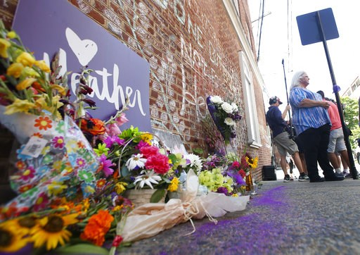 (AP Photo/Steve Helber). Susan Bro, mother of Heather Heyer who was killed during last year's Unite the Right rally, speaks with reporters at the spot where her daughter was killed in Charlottesville, Va., Friday, Aug. 10, 2018. The governor has declar...