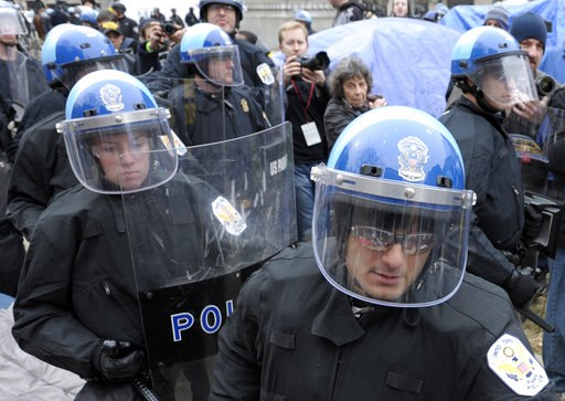 (AP Photo/Cliff Owen). FILE - In this Feb. 4, 2012 file photo, U.S. Park Police are seen working in riot gear in Washington.  Government and police officials in the nation's capital say they are confident the city can manage to host this weekend's plan...