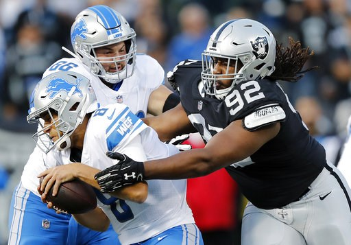 (AP Photo/John Hefti). Detroit Lions quarterback Matt Cassel, left, is sacked by Oakland Raiders nose tackle P.J. Hall (92) during the first half of an NFL preseason football game in Oakland, Calif., Friday, Aug. 10, 2018.